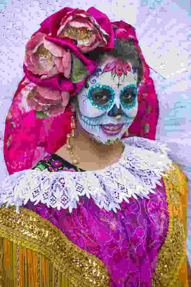 A girl participating in the Day Of The Dead festival in Oaxaca, Mexico (Shutterstock)