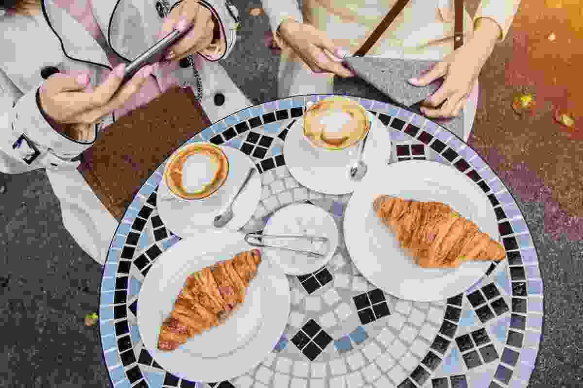 Coffee and croissants outside of a stylish Paris cafe (Shutterstock)
