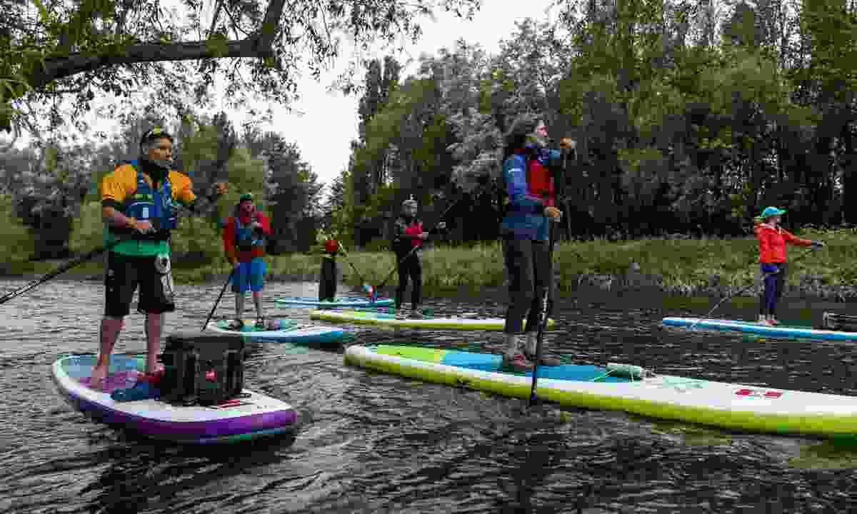 Richard Harpham (far left) guiding the group along the river (GlobalShots)