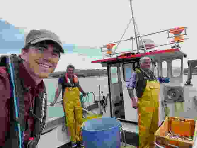 Simon pops onto a fishing boat to lend a hand (Chris Mitchell/ Beagle Media Ltd/BBC)