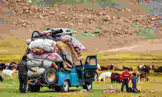 A family pack their gers onto a truck (Marcus Westberg)