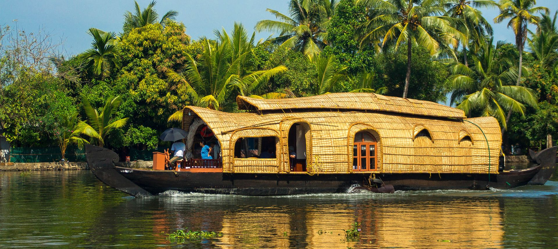 Enjoy a boat trip anywhere in the world, like this houseboat in Kerala, India (Shutterstock)