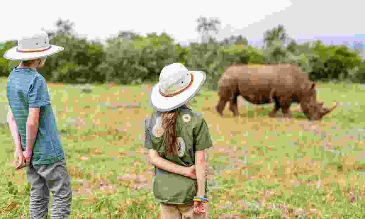 Kids watching a rhino in Kenya (Dreamstime)