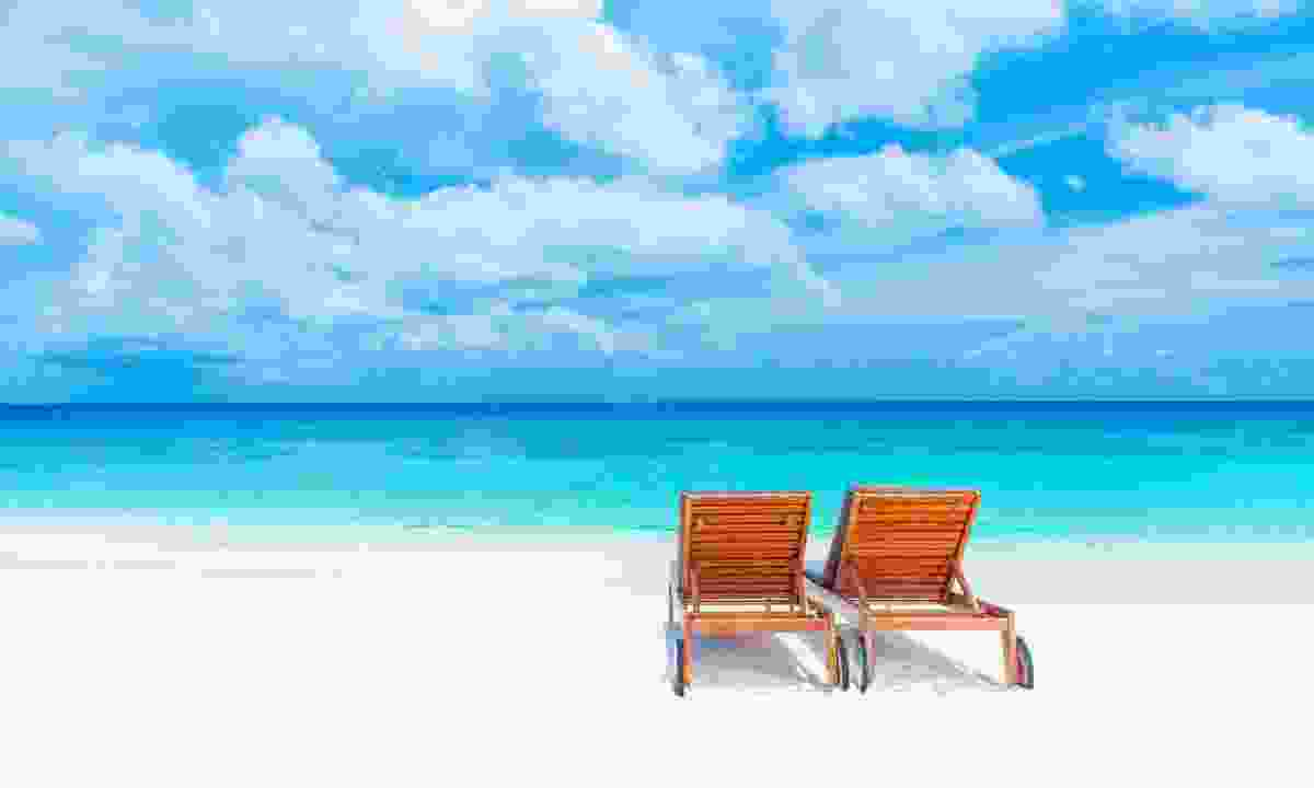 Empty sunbeds on a beach in the Maldives (Dreamstime)