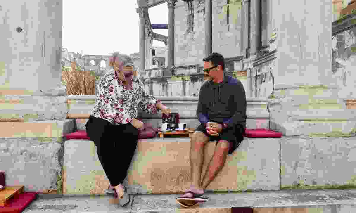 Couple enjoying coffee in Peristil Square (Peter Moore)