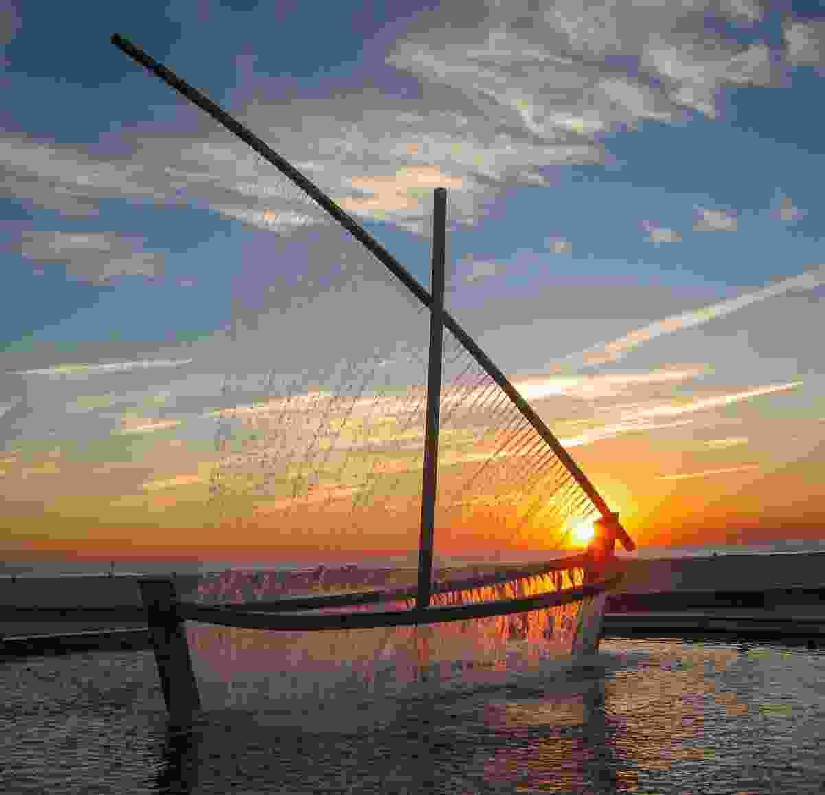 Sailboat fountain at sunrise (Shutterstock)