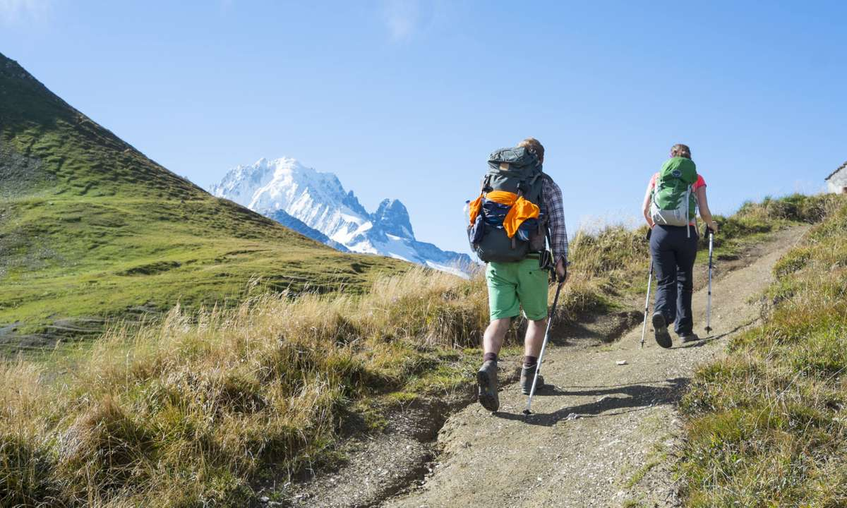 Trekking with views of Mont Blanc on the horizon (Dreamstime)