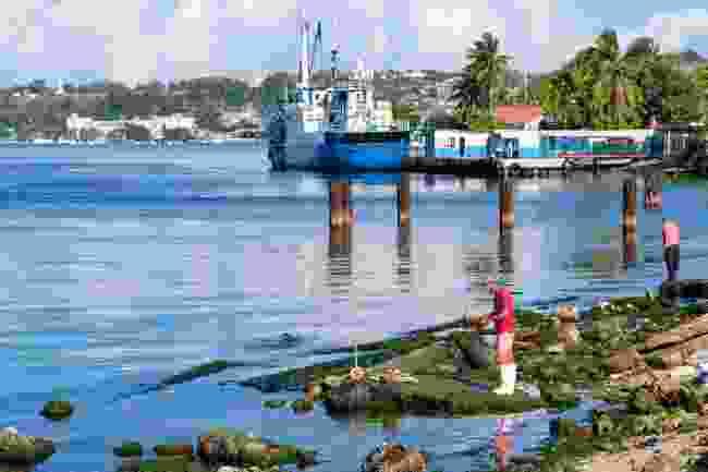 Fishermen working off Regla's coast (Shutterstock)