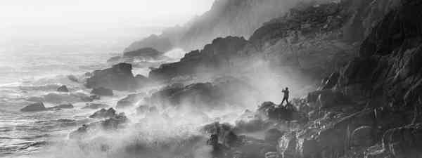 Living the View Adult Class Winner: 'Fisherman on Rocks in Strong Westerly Winds' in Porth Nanven, Cornwall (Mick Blakey)