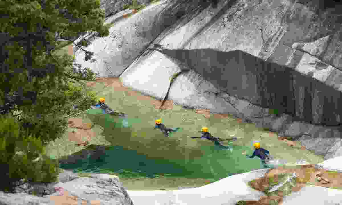 Canyoning in the emerald waters (Massimo-Fotolia.com)