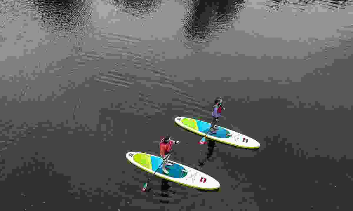 Paddleboarding along the River Great Ouse (GlobalShots)
