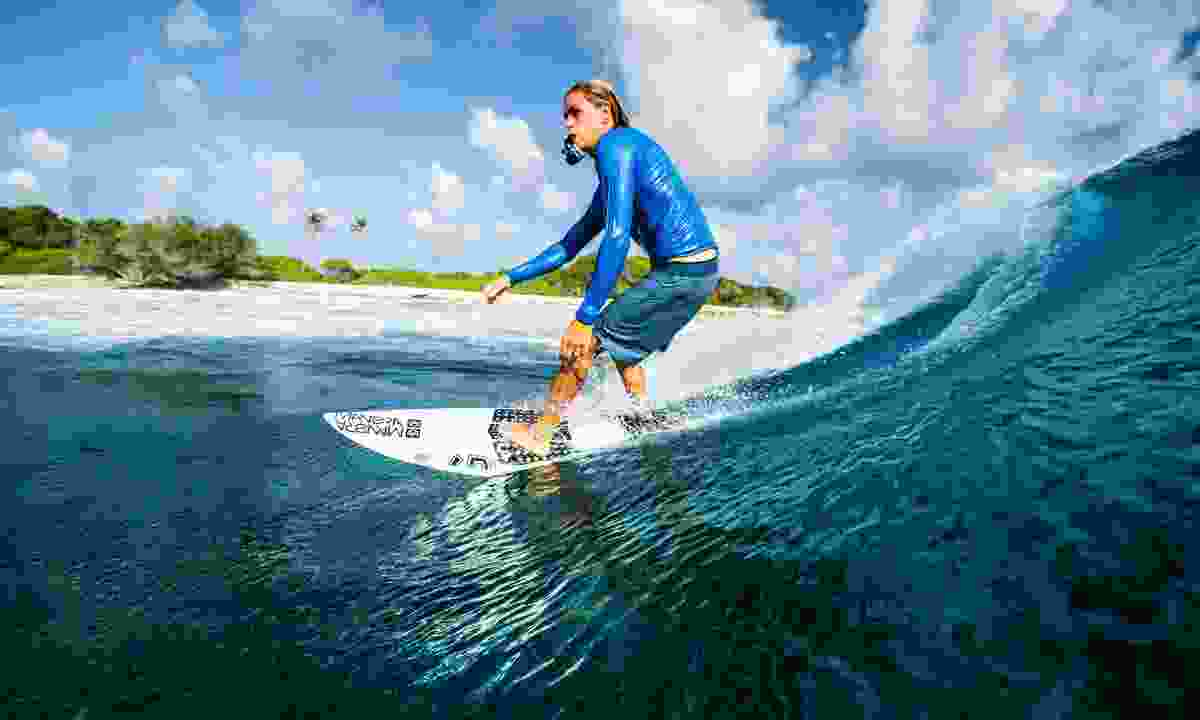 Surfing in the Maldives (Shutterstock)