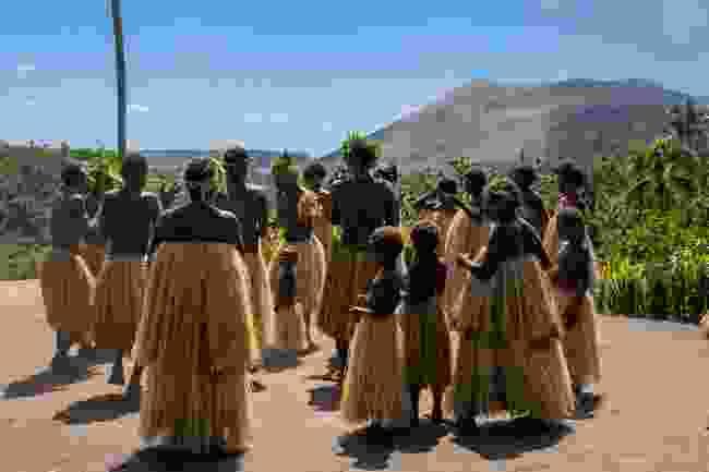 Villagers on Tanna Island, Vanuatu in the shadow of Mt Yasur (Shutterstock)