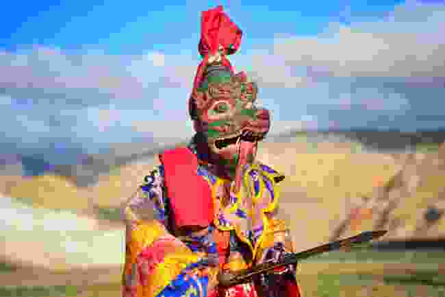A masked festival performer in Lo Manthang, Tibet (Shutterstock)