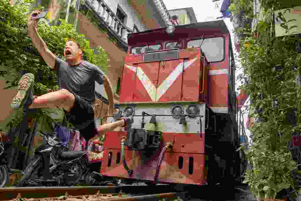 A tourist taking a selfie in Vietnam (Shutterstock)