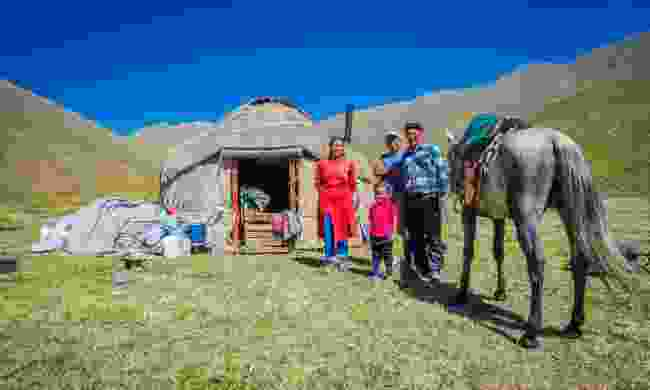 Nomad family on the steppes of Kyrgyzstan (Dreamstime)