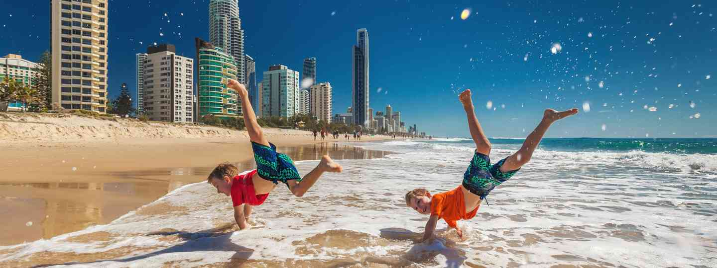 Kids playing on the beach on Australia's Gold Coast (Dreamstime)