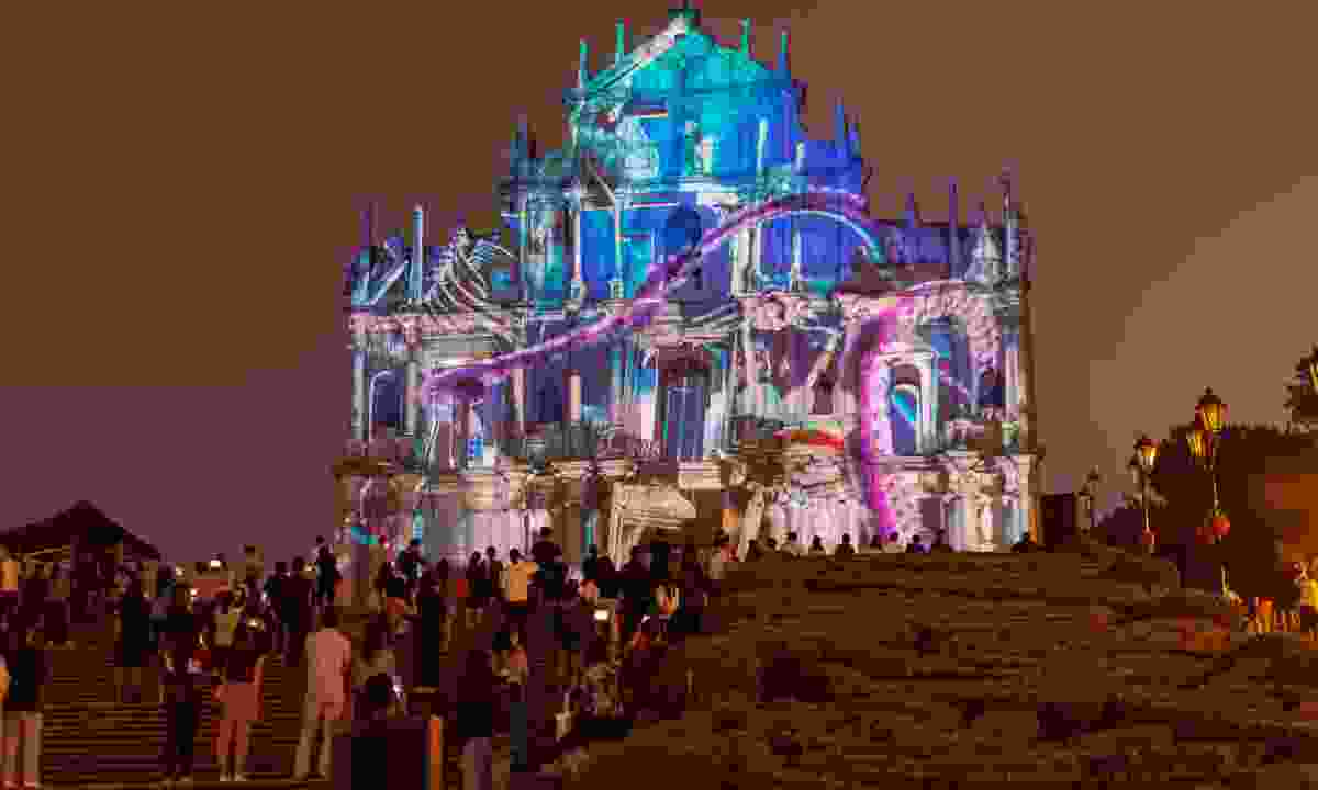 Crowds watch illuminations projected on the ruins of St Paul's in Macau (Shutterstock)