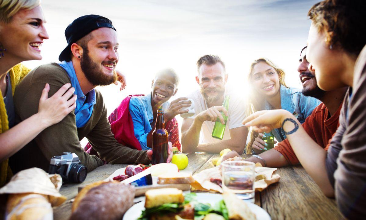 Group of friends enjoying a meal (Shutterstock)