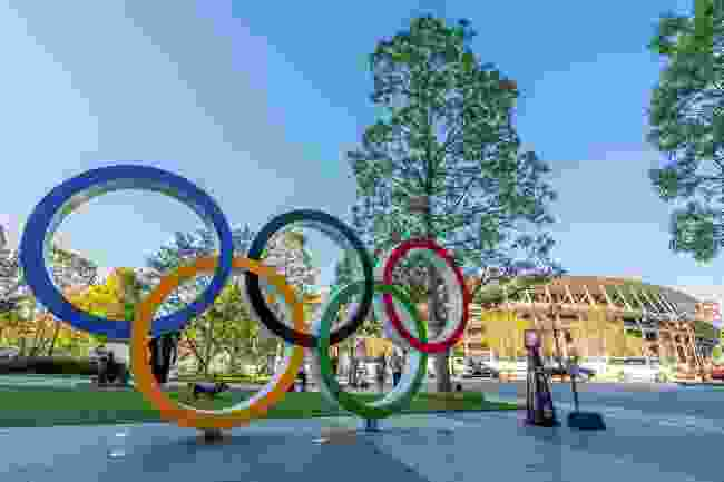 Tokyo's 2020 Olympic rings and stadium (Shutterstock)