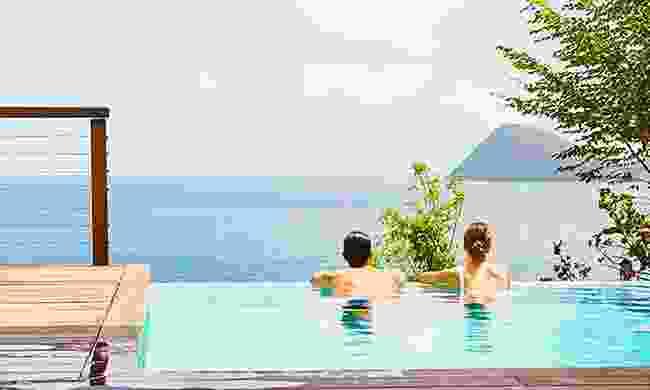 Relaxing in an infinity pool overlooking the ocean
