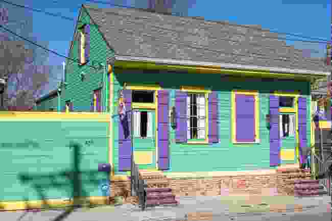 A purple, green and gold house in New Orleans (Shutterstock)