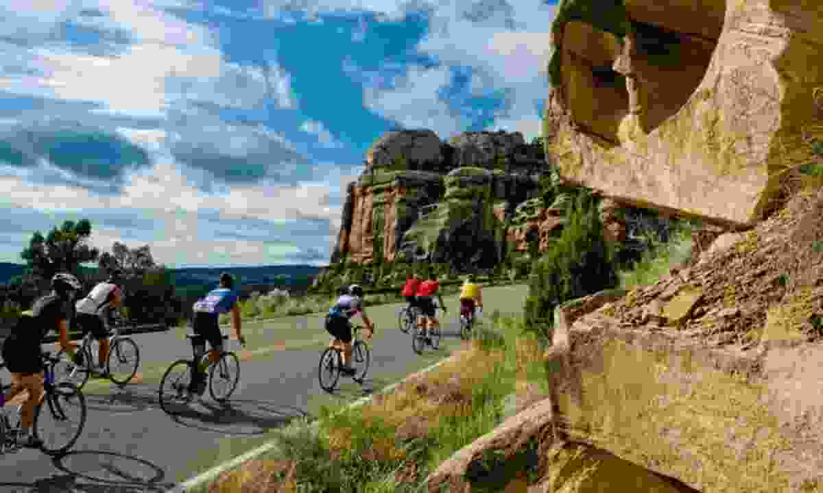 Cycling through the mountains (At Your Pace/Colorado.com)