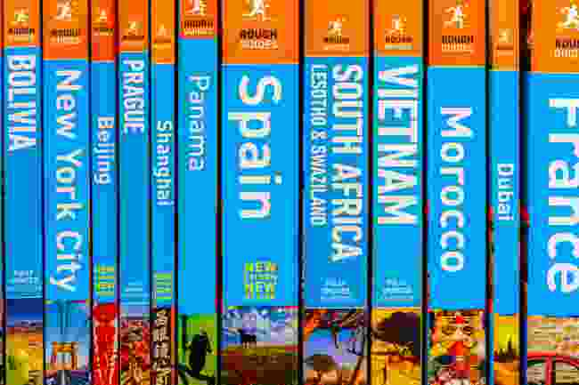 Travel guides on a bookshelf (Shutterstock)