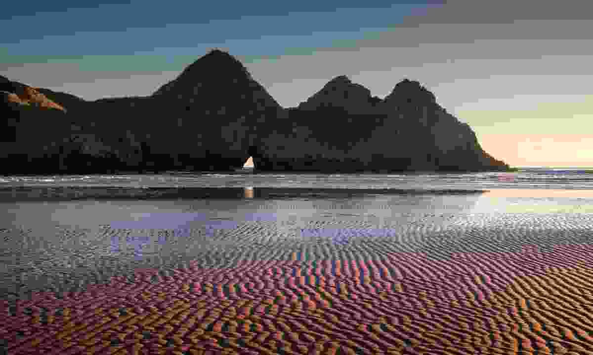 Rippled sand landscape at Three Cliffs Bay (Shutterstock)