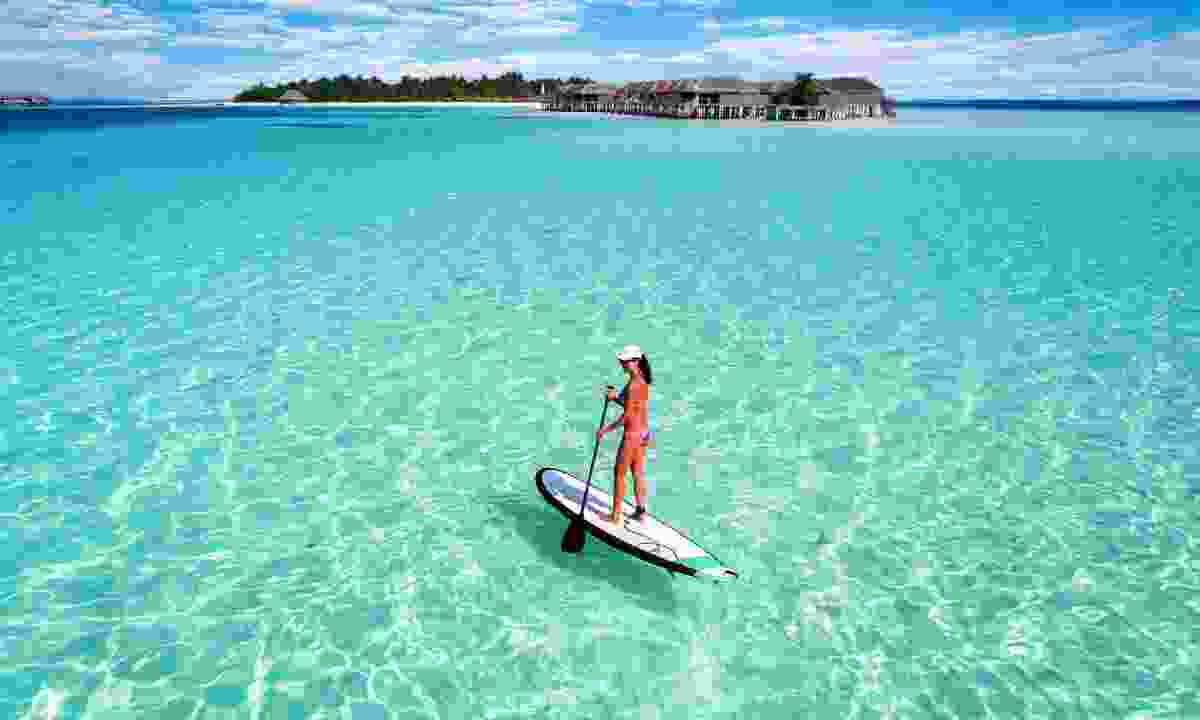 Paddleboarding in the Maldives (Shutterstock)