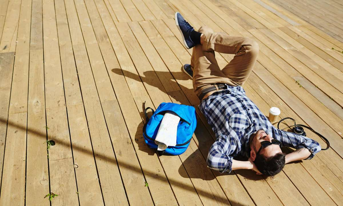 Man relaxing in sun (Dreamstime)