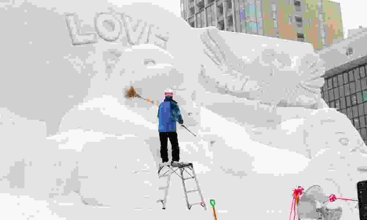 Battling to keep fresh snow off the bear sculpture (Graeme Green)