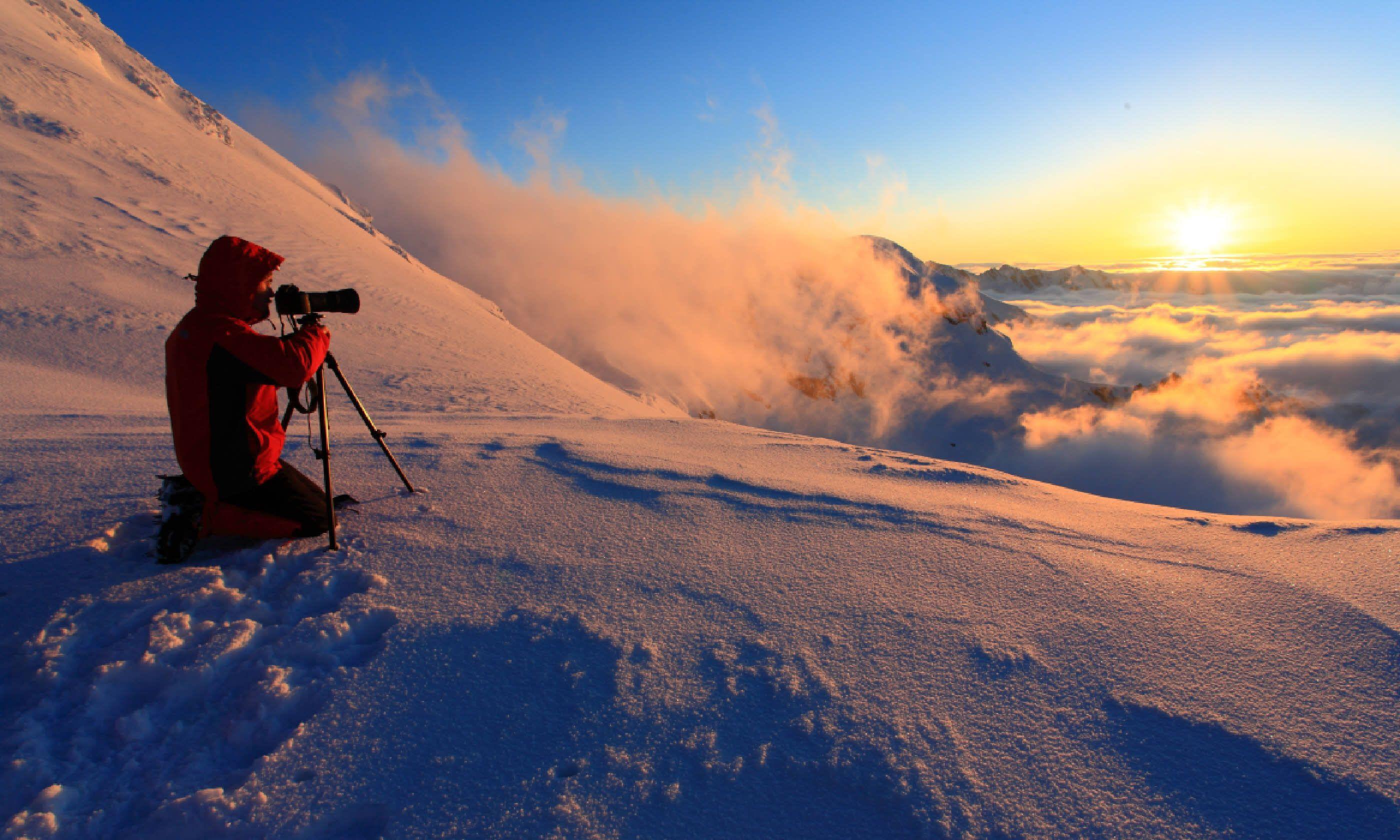 Photographer at sunset (Shutterstock)
