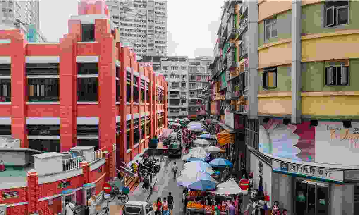 The three-storey Red Market is one of the iconic buildings of the neighbourhood (MGTO)