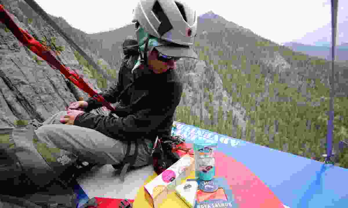 Preparing cheese and crackers on the ledge in Colorado (Phoebe Smith)