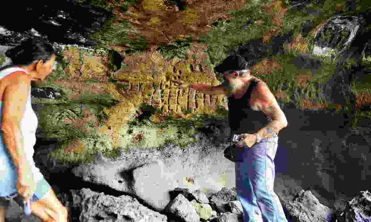 Sailor Bob points out petroglyphs at 'Down the Gods' (Mark Stratton)