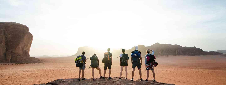 Tourists salute the sun at Wadi Rum (Shutterstock)