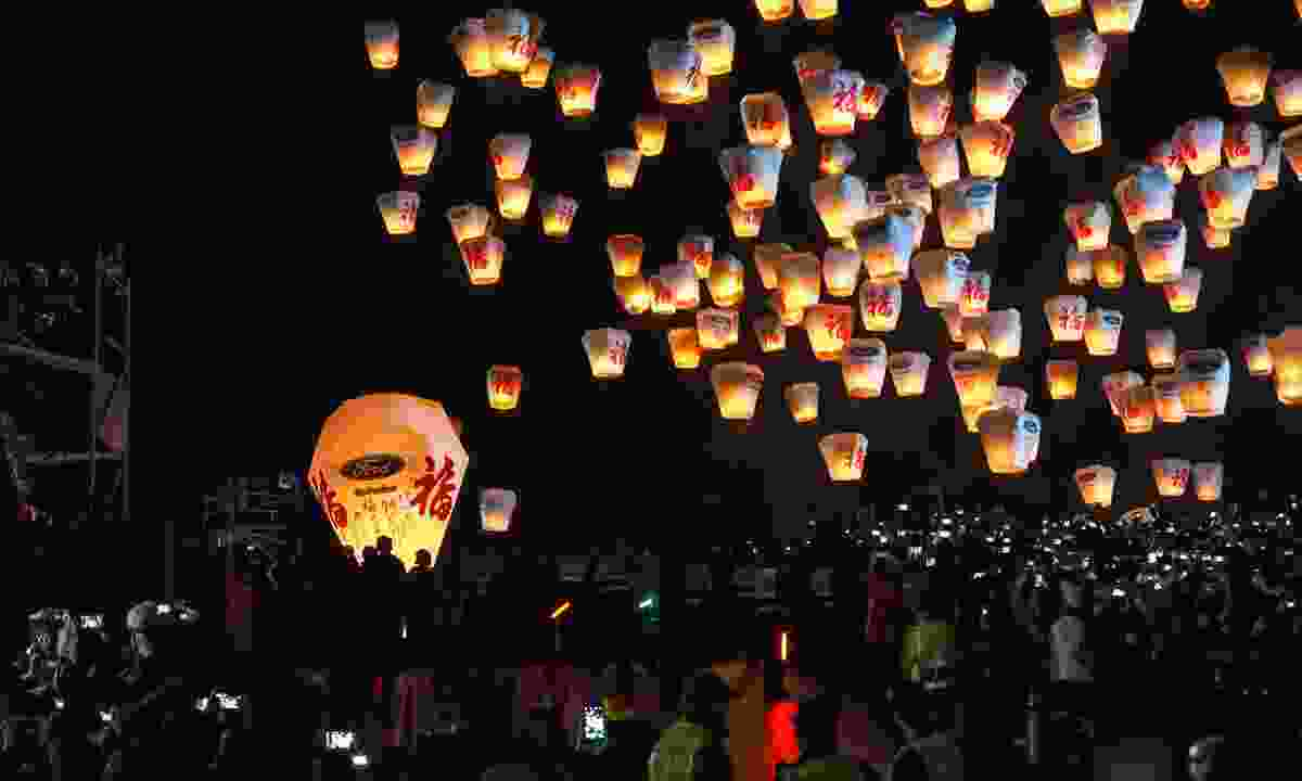 Lanterns launched into the sky during Pingxi Sky Lantern Festival (Shutterstock)
