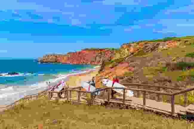 Surfers at Praia Do Amado (Shutterstock)