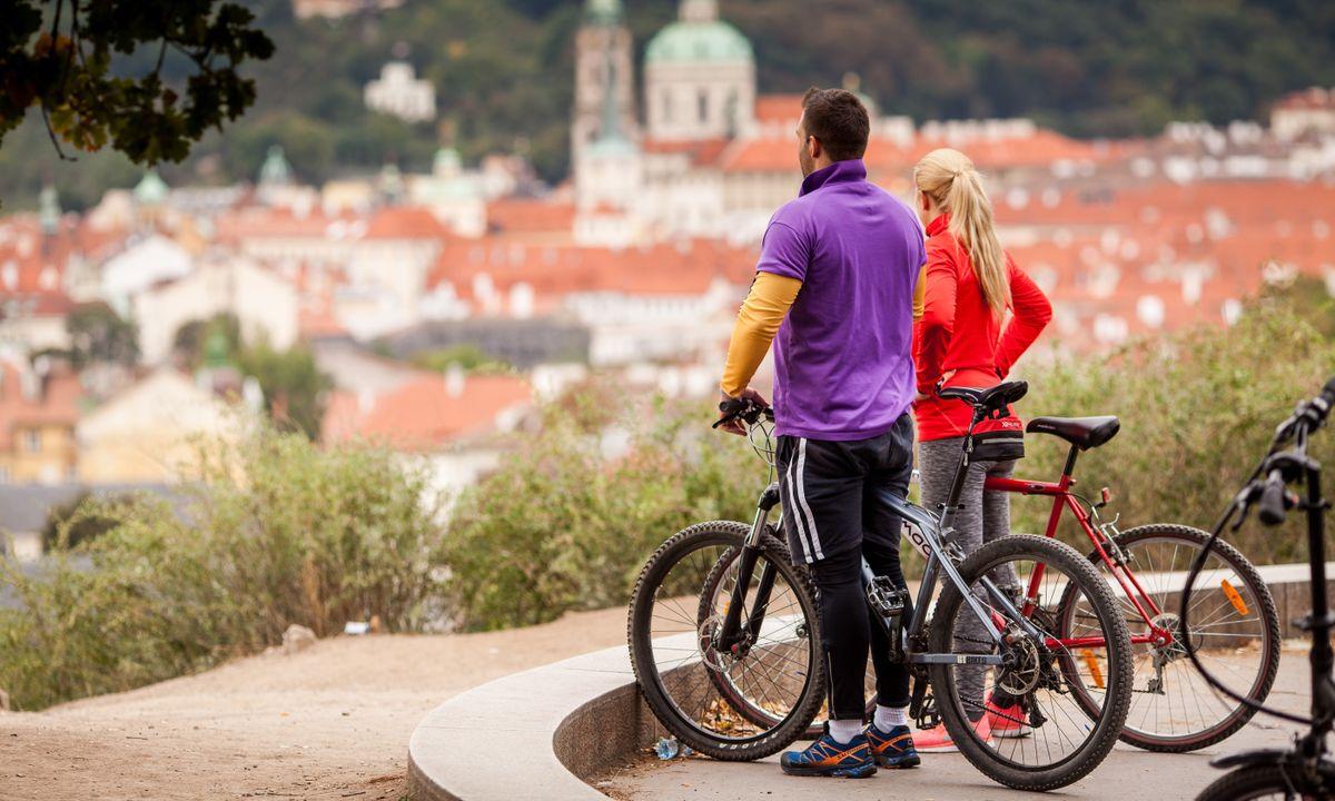 Cyclist looking across Prague (Shutterstock)