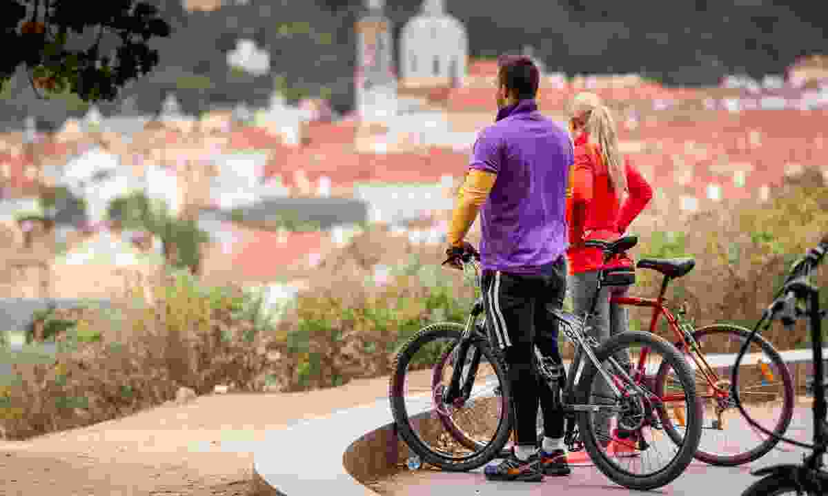 Cyclist looking across Prague (Shutterstock)