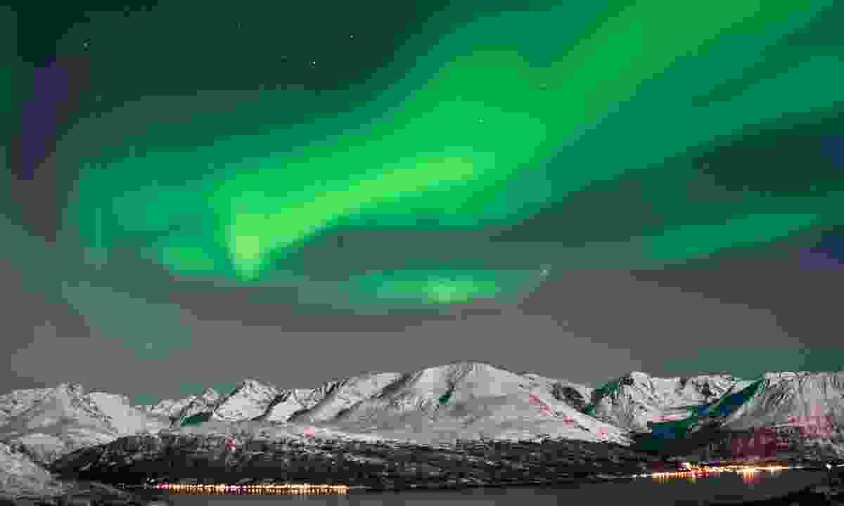 Aurora above fjords near Skibotn, Norway (Dreamstime)