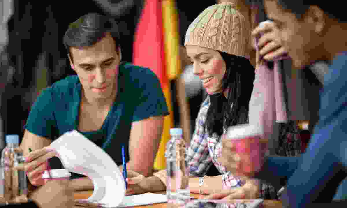 A group of young adults exchanging ideas (Dreamstime)