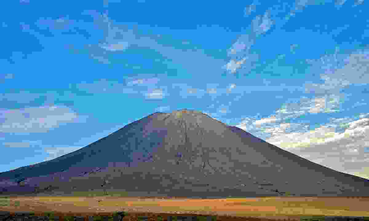 The perfect cone-shaped Lengai Volcano (Dreamstime)