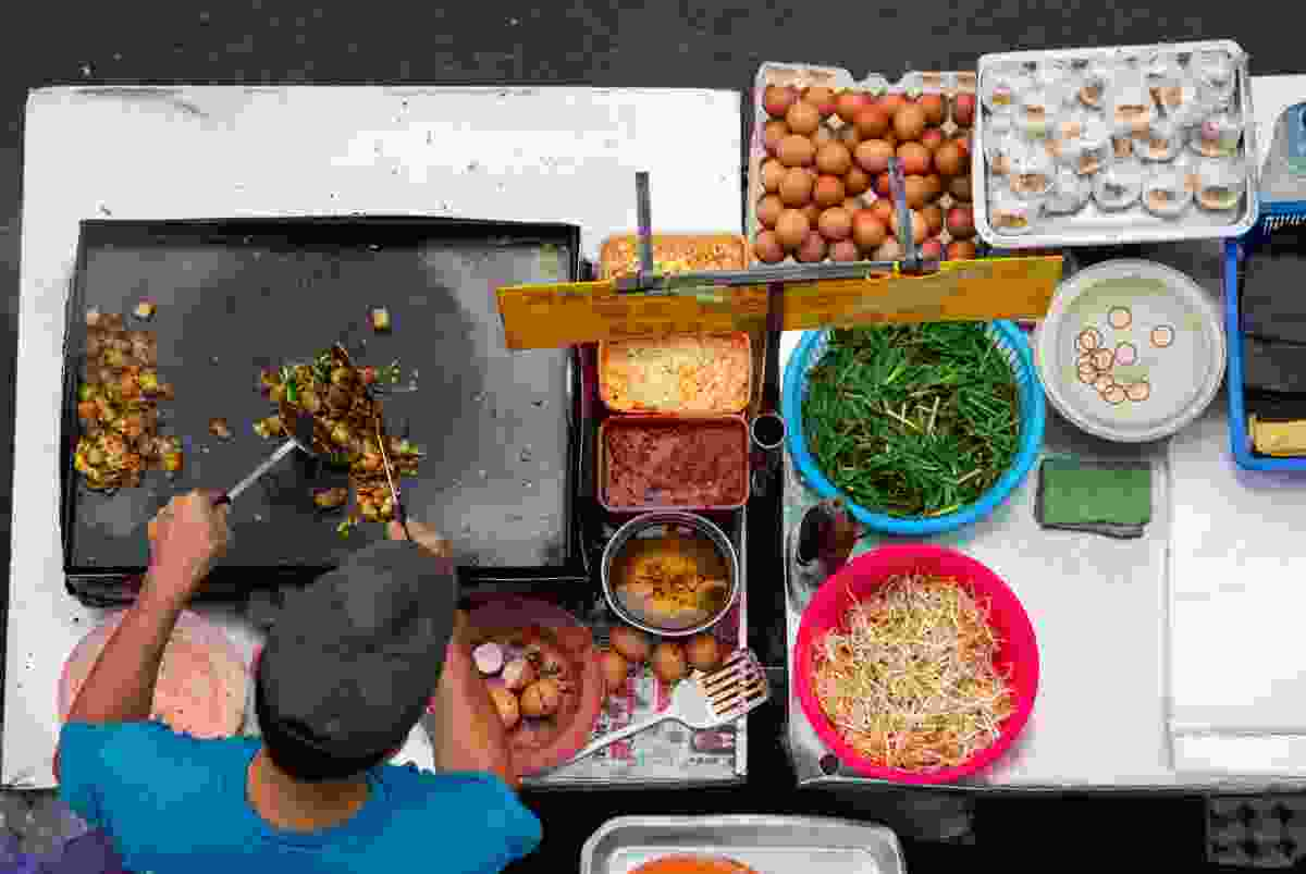 A street food vendor in Malaysia, hard at work (Shutterstock)