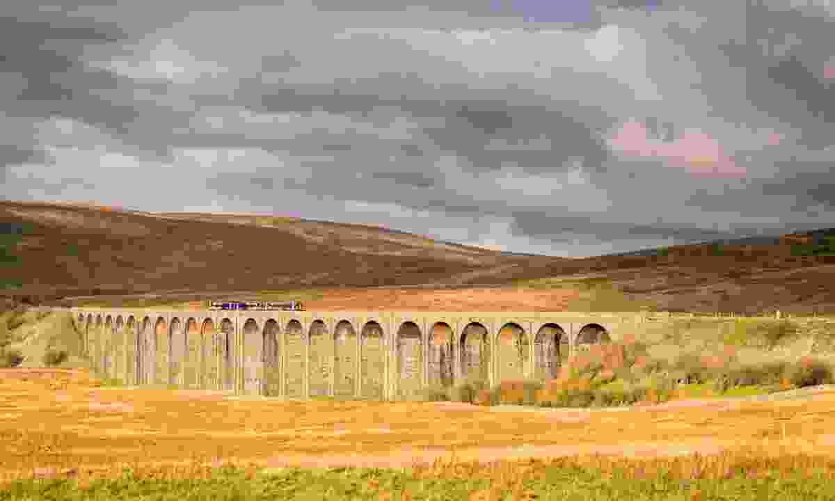 The train crossing Ribblehead viaduct (Dreamstime)