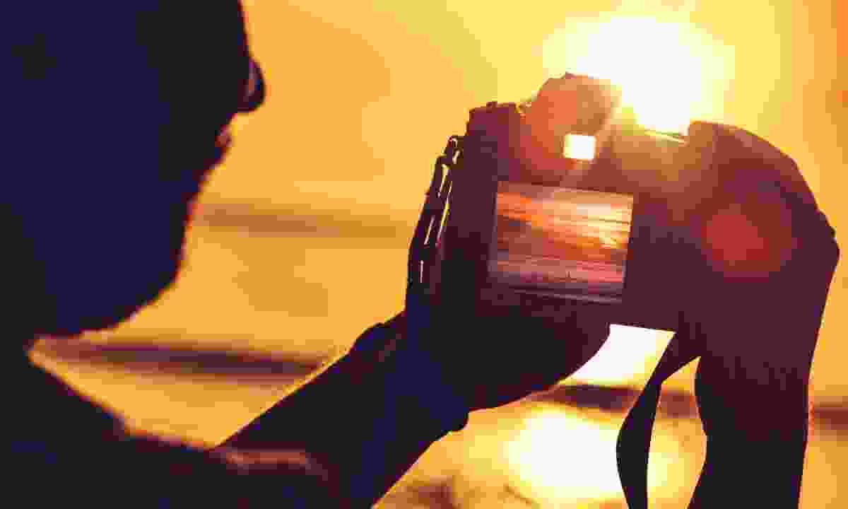 Taking photos (Dreamstime)