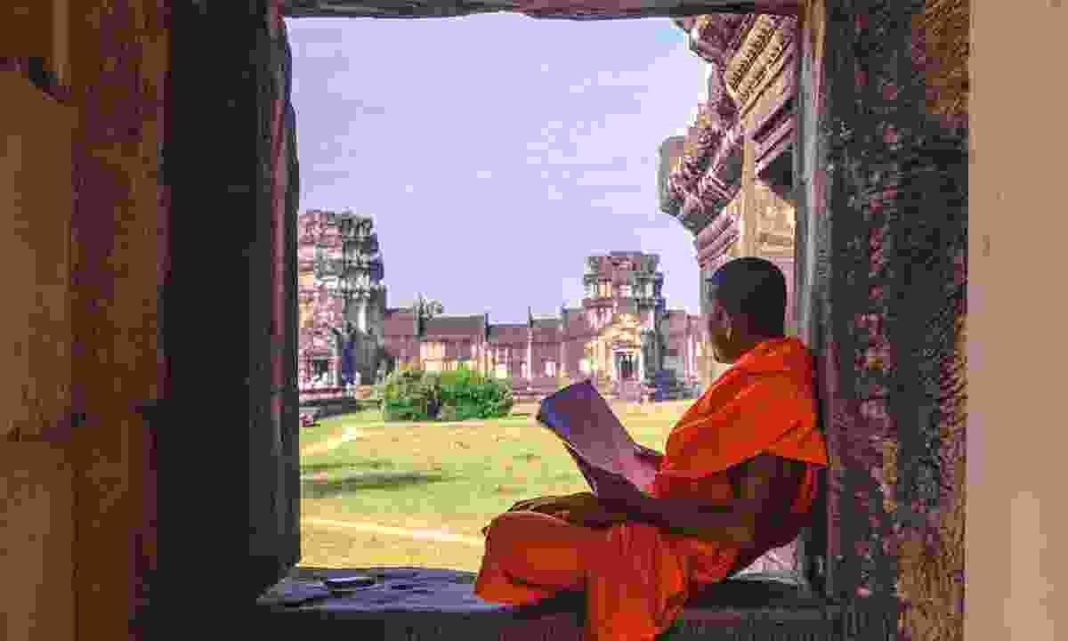 Monk studying at Angkor Wat (Dreamstime)