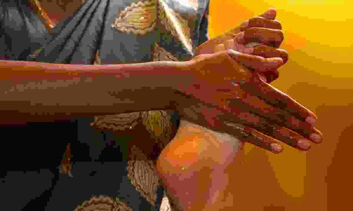 Enjoy a traditional foot massage in India (Dreamstime)