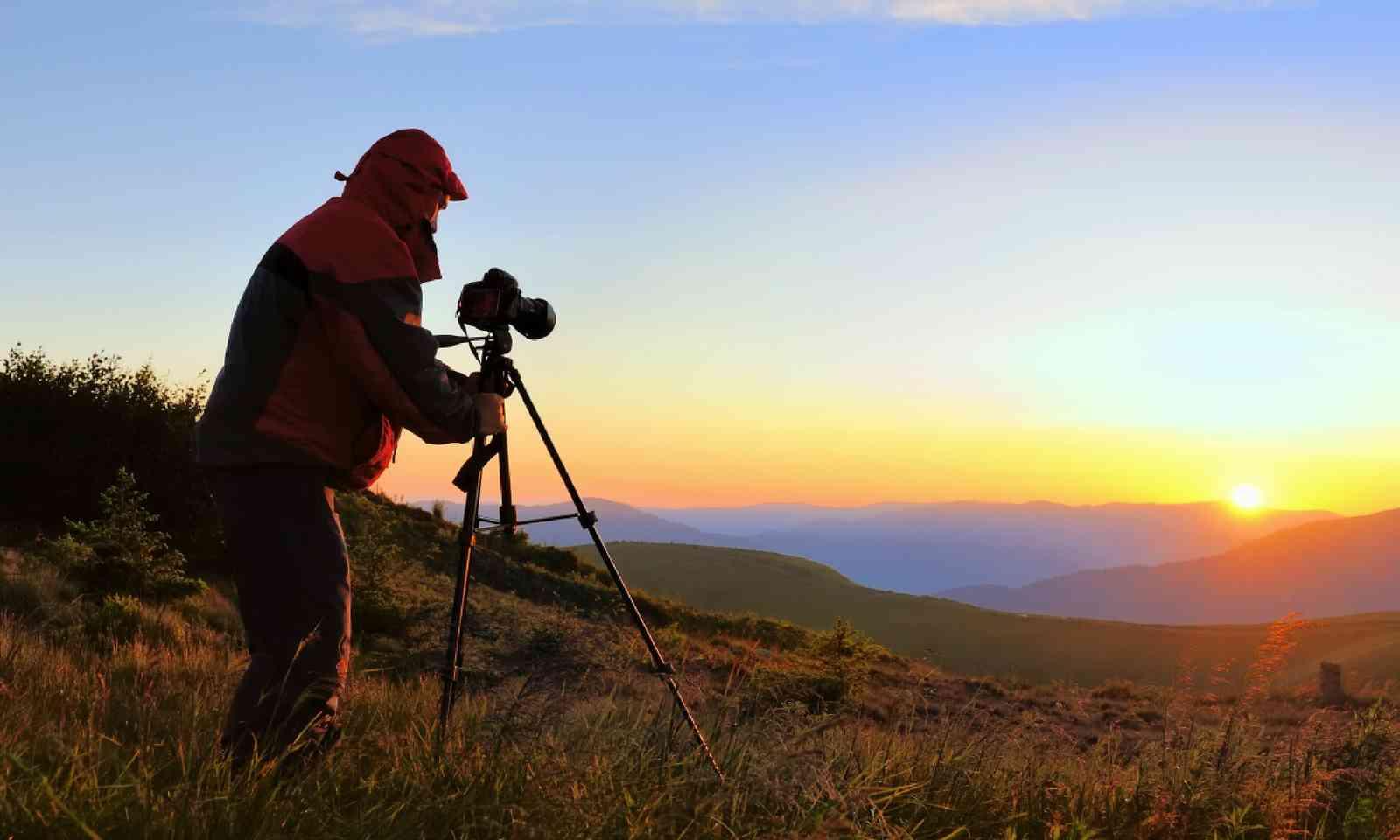 Photographer using a tripod (Shutterstock)